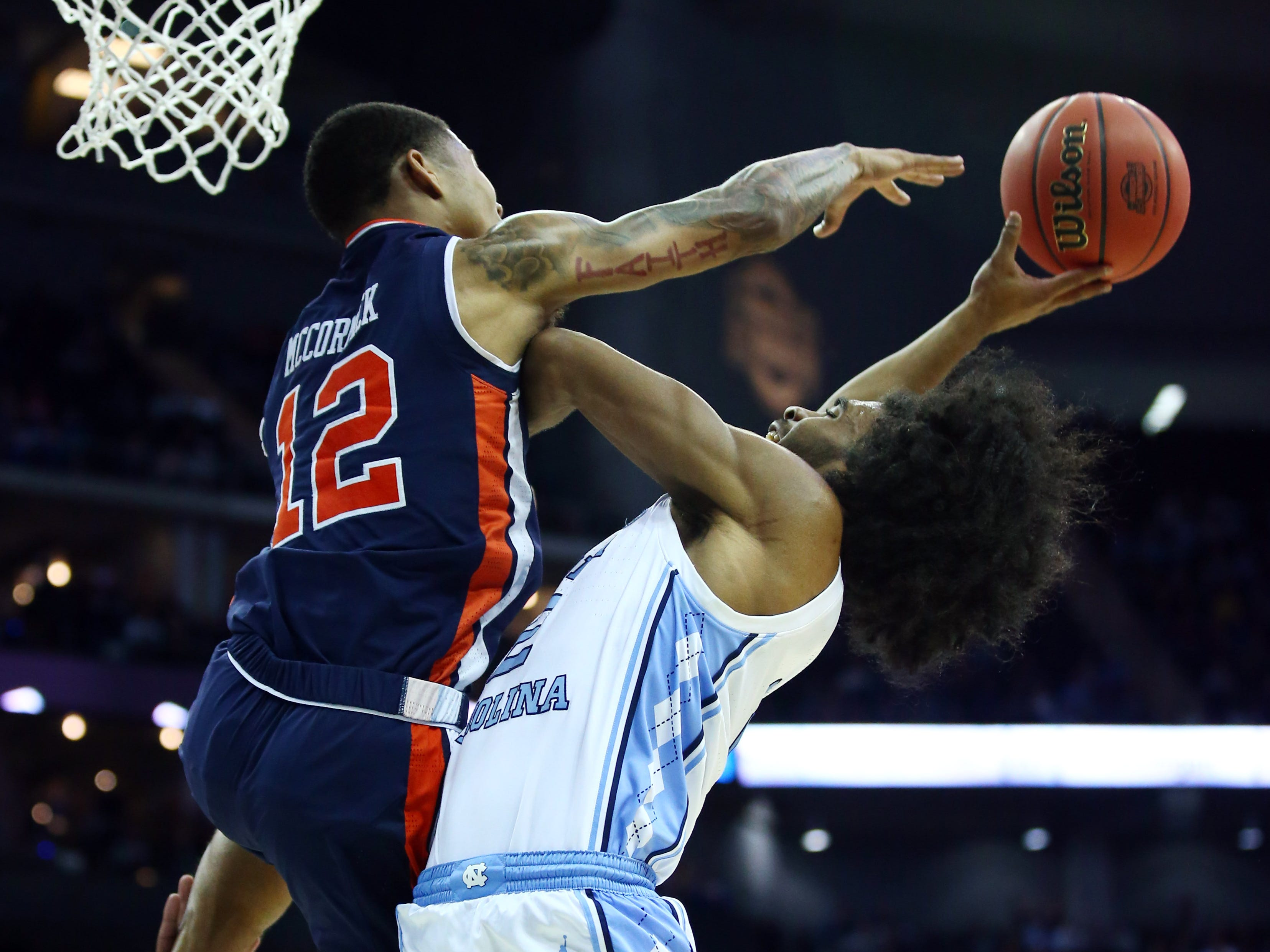 Mar 29, 2019; Kansas City, MO, United States; Auburn Tigers guard J'Von McCormick (12) blocks the shot of North Carolina Tar Heels guard Coby White (2) during the first half in the semifinals of the midwest regional of the 2019 NCAA Tournament at Sprint Center. Mandatory Credit: Jay Biggerstaff-USA TODAY Sports