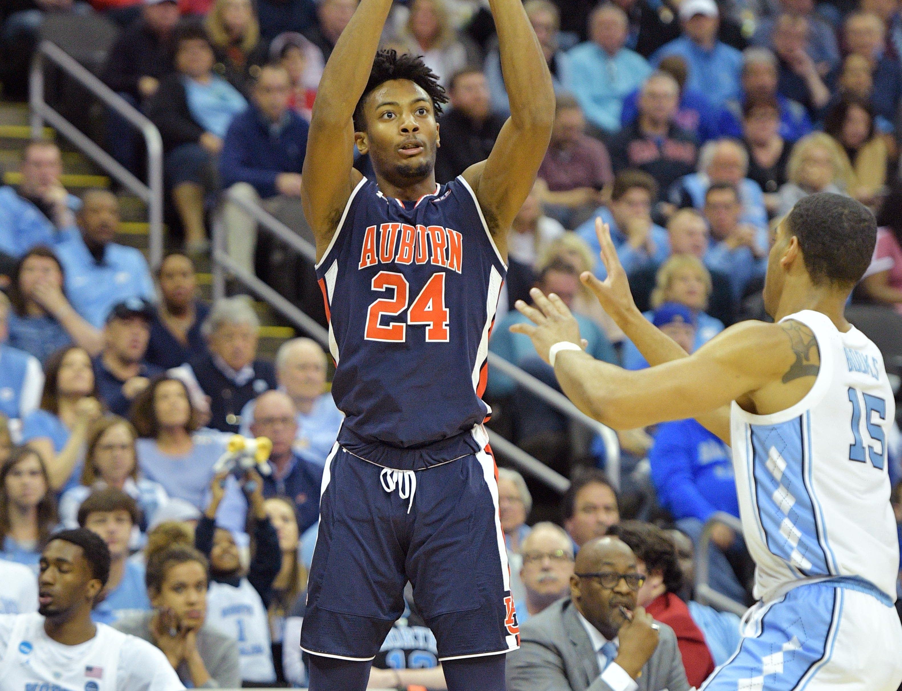 Mar 29, 2019; Kansas City, MO, United States; Auburn Tigers forward Anfernee McLemore (24) shoots over North Carolina Tar Heels forward Garrison Brooks (15) during the first half in the semifinals of the midwest regional of the 2019 NCAA Tournament at Sprint Center. Mandatory Credit: Denny Medley-USA TODAY Sports