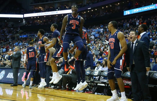 Auburn forward Danjel Purifoy (3) celebrates with teammates against North Carolina in the Sweet 16 of the NCAA Tournament at Sprint Center on Marchh 29, 2019, in Kansas City, Mo.