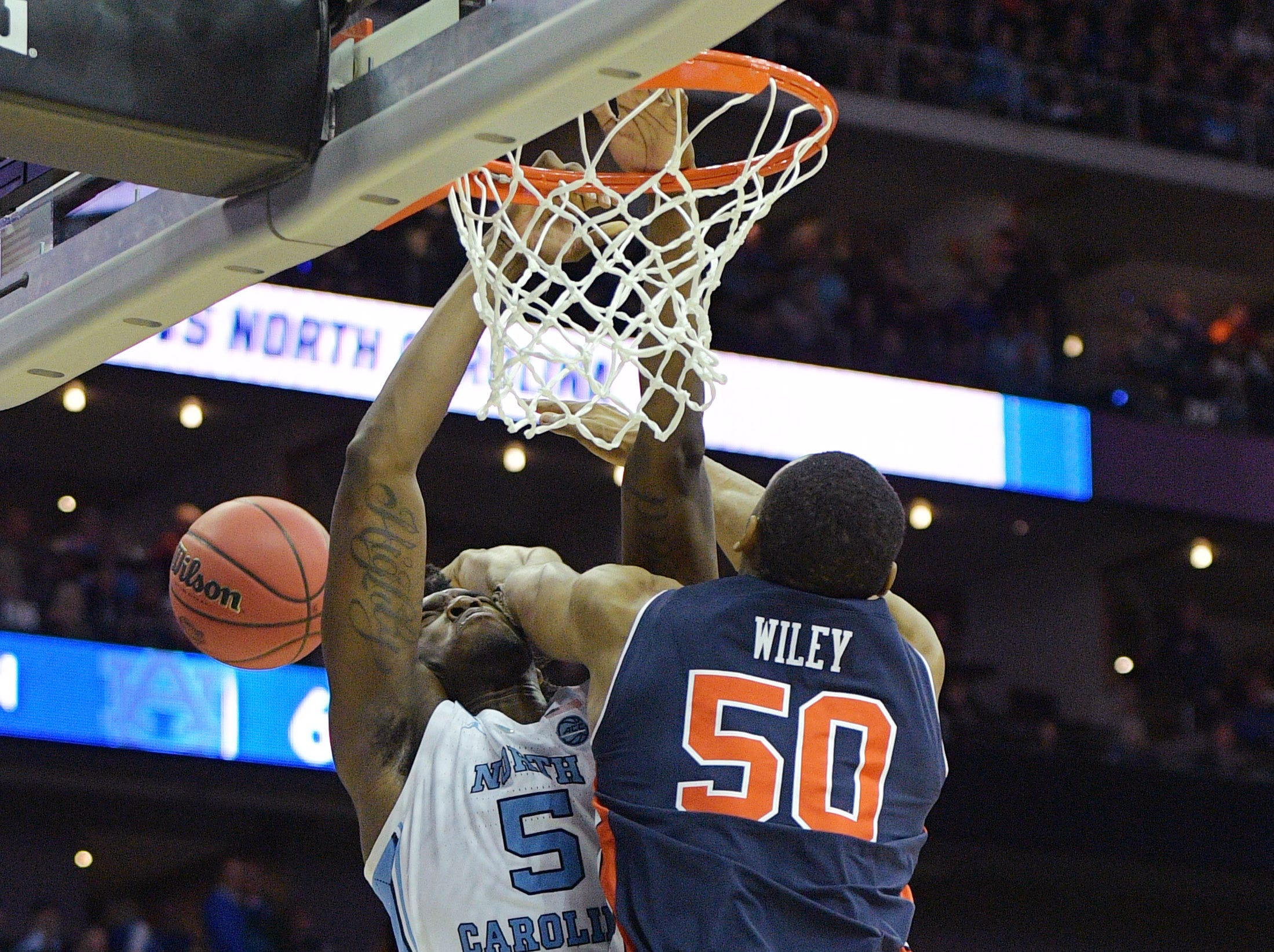 Mar 29, 2019; Kansas City, MO, United States; Auburn Tigers center Austin Wiley (50) knocks the ball away from North Carolina Tar Heels forward Nassir Little (5) during the second half in the semifinals of the midwest regional of the 2019 NCAA Tournament at Sprint Center. Mandatory Credit: Denny Medley-USA TODAY Sports