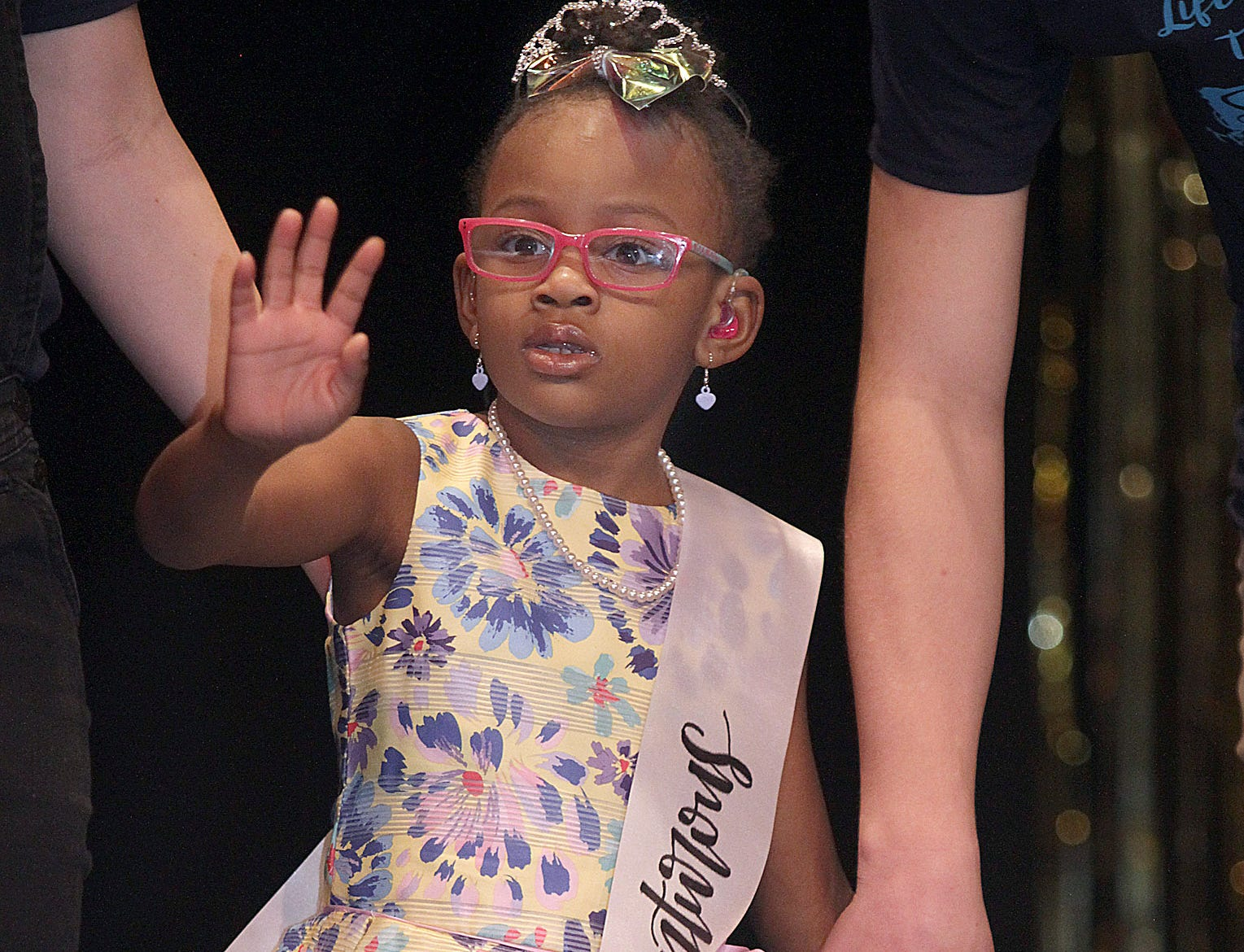 Aaliyah Scruggs (6) waves to the crowd at The Sparkle Pageant at Pope John Paul II High School on Saturday, March 30, 2019.