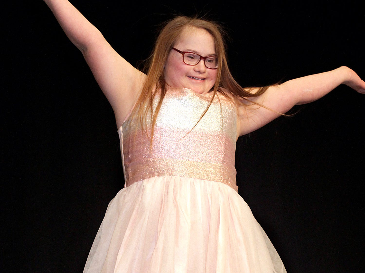 Caroline Moore (13) shows off her dance moves at The Sparkle Pageant at Pope John Paul II High School on Saturday, March 30, 2019.