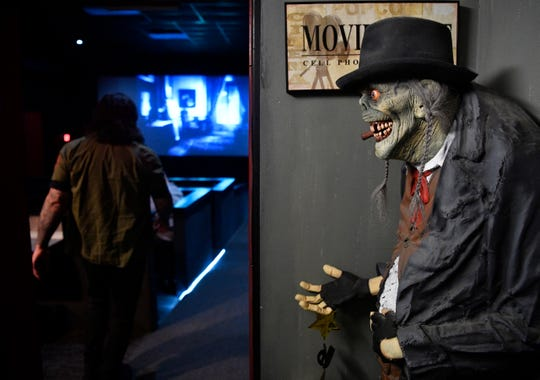 This character greets moviegoers at Full Moon Cineplex on Lebanon Pike in Hermitage, where owners Ben and Stacey Dixon often show horror films.