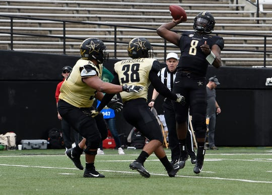 Vanderbilt quarterback Jamil Muhammad (8) throws a pass over defensive lineman Daevion Davis (55) and safety Gil Barksdale (38) during their spring game at Vanderbilt Stadium Saturday, March 30, 2019 in Nashville, Tenn.