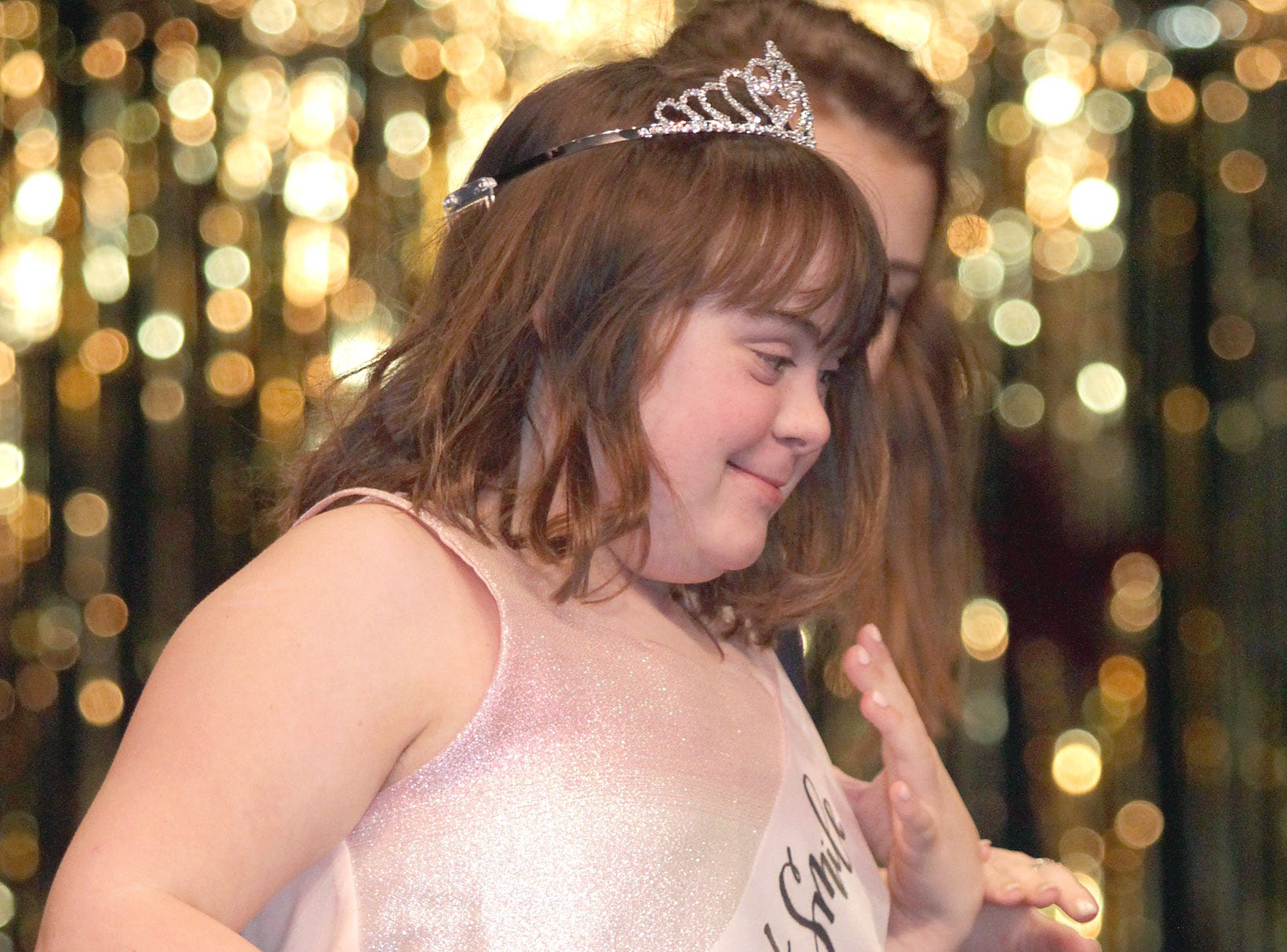 Hannah Dodd (14) wears her Beautiful Smile Sash at The Sparkle Pageant at Pope John Paul II High School on Saturday, March 30, 2019.