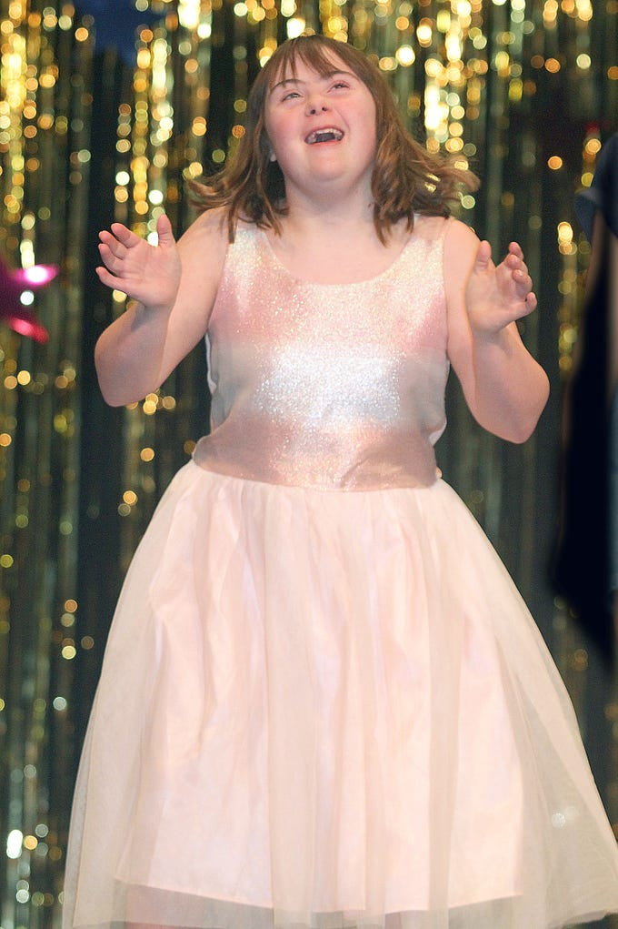 Hannah Dodd (14) applauds as she walks in The Sparkle Pageant at Pope John Paul II High School on Saturday, March 30, 2019.