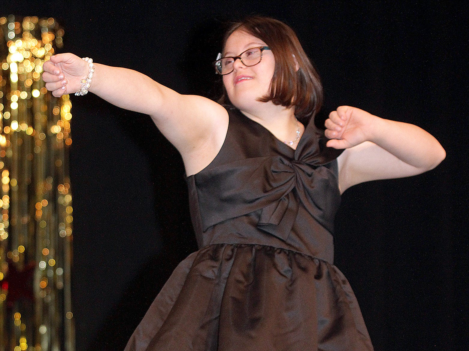 Lilli Reep (15) does some dance moves at The Sparkle Pageant at Pope John Paul II High School on Saturday, March 30, 2019.