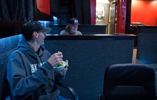 """John Elks talks with Landon Lee as they enjoy dinner before the screening of """"Death Wish"""" at Full Moon Cineplex on March 29."""