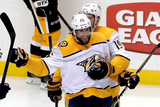 Nashville Predators' Craig Smith (15) celebrates his goal with Calle Jarnkrok (19) during the first period against the Pittsburgh Penguins in Pittsburgh on Friday.