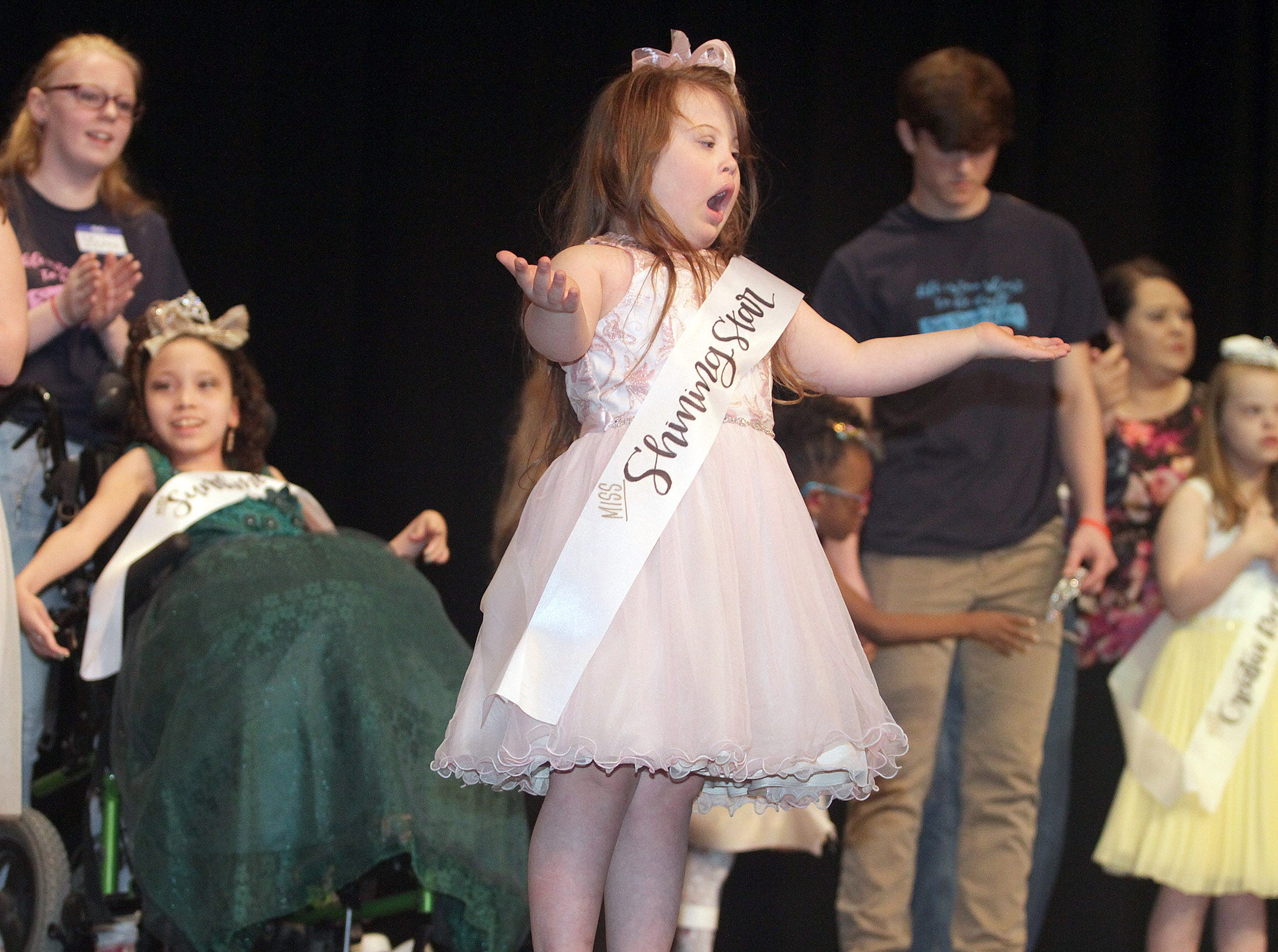 Tori Jenkins (6) owns the stage at The Sparkle Pageant at Pope John Paul II High School on March 30, 2019.