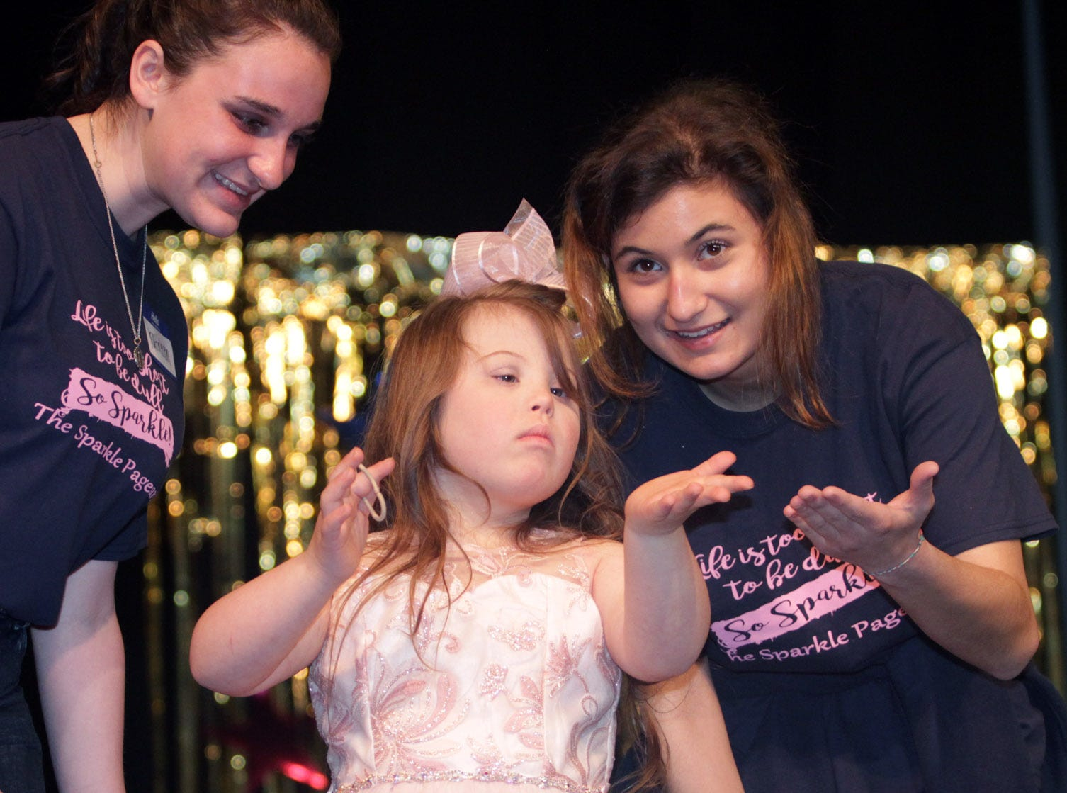 Tori Jenkins (6) blows kisses to the crowd at  The Sparkle Pageant at Pope John Paul II High School on Saturday, March 30, 2019.