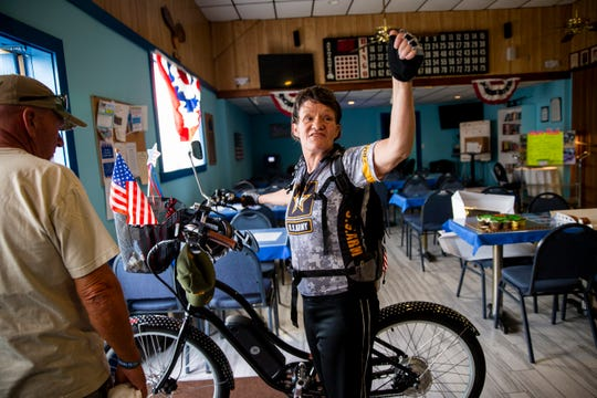 Ché Orr says goodbye to her friends at American Legion Post 135 in East Naples before starting her bike ride to American Legion Post 274 in Fort Myers Beach on Saturday, March 30, 2019. Orr hopes to make this ride annually to raise money for veterans.