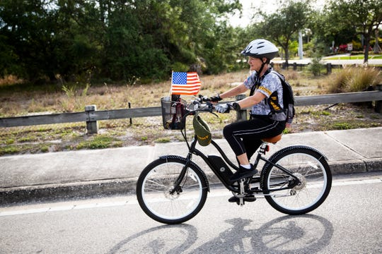 Ché Orr rides an electric bike that was donated to her by multiple veterans groups, including The Forty and Eight, American Legion Auxiliary, AMVETS, AMVETS Ladies Auxiliary, and Sons of the American Legion, along U.S. 41, from American Legion Post 135 in East Naples to American Legion Post 274 in Fort Myers Beach on Saturday, March 30, 2019. Orr, who served in the Army for 12 years and now experiences seizures that prevent her from driving, says that this ride is her way of saying thank you through action and giving back by raising money for veterans.