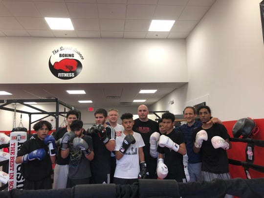 """Former middleweight champion Kelly """"The Ghost"""" Pavlik came to town to support his longtime friend and Sweet Science owner, Billy Lyell, and to raise funds for the Eastside Boxing Club — the gym's youth organization — on Friday."""