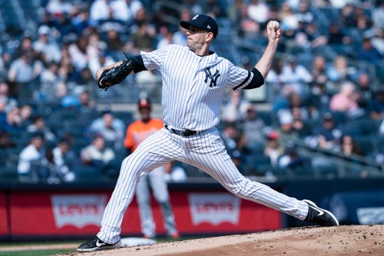 New York Yankees pitcher James Paxton (65) delivers a pitch against the Baltimore Orioles during the second inning at Yankee Stadium.