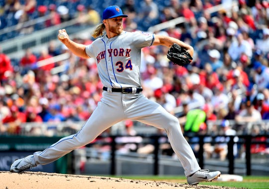 Mar 30, 2019; Washington, DC, USA; New York Mets starting pitcher Noah Syndergaard (34) throws to the Washington Nationals during the second inning at Nationals Park. Mandatory Credit: Brad Mills-USA TODAY Sports
