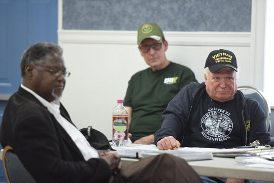 "Members of Disabled American Veterans Northern Chapter 32 in Bergenfield, including Bob Brown of Palisades Park, Brian Doyle of Bergenfield and Ken Lazar of Park Ridge  attend a book reading and signing with Vietnam veteran Mitchell Barnett of Fort Lee, not pictured, on March 30, 2019. Barnett recently published his memoir, ""When We Die, We're All Going to Heaven, Because We've All Been Through Hell."""