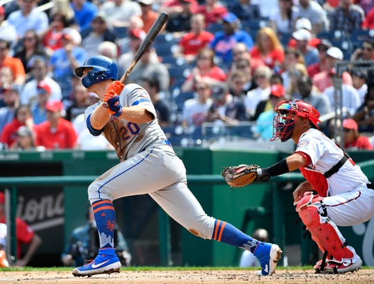 Mar 30, 2019; Washington, DC, USA; New York Mets first baseman Pete Alonso (20) hits an RBI double against the Washington Nationals during the second inning at Nationals Park. Mandatory Credit: Brad Mills-USA TODAY Sports
