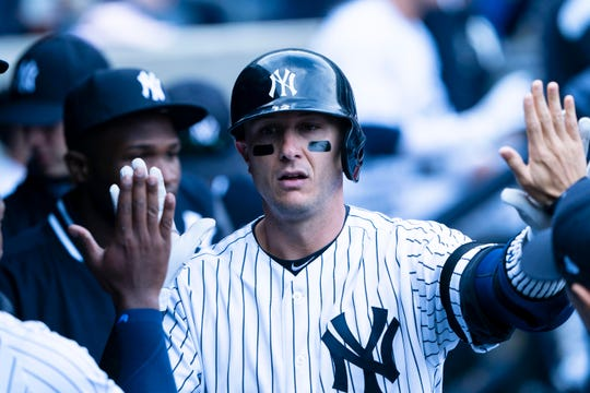 New York Yankees shortstop Tory Tulowitzki (12) is congratulated by teammates in the dugout after hitting a home run during the ninth inning against the Baltimore Orioles at Yankee Stadium.