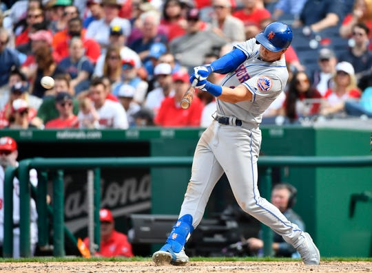 Mar 30, 2019; Washington, DC, USA; New York Mets second baseman Jeff McNeil (6) hits an RBI single against the Washington Nationals during the eighth inning at Nationals Park. Mandatory Credit: Brad Mills-USA TODAY Sports
