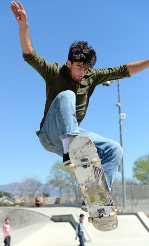 Jon Rogers rides his skateboard at the Las Cruces skatepark on March 28, 2019.