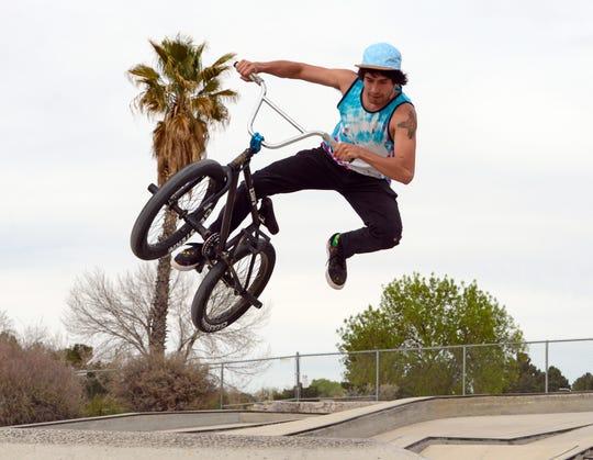 Michael Jimenez flies through the air on his BMX bike at the Las Cruces skatepark on March 27, 2019.