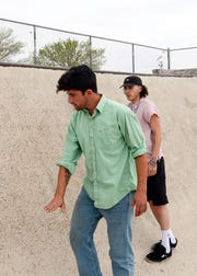 Skateboarder Jon Rogers explains why the slopes at the Las Cruces skatepark are too steep to ride on March 27, 2019.