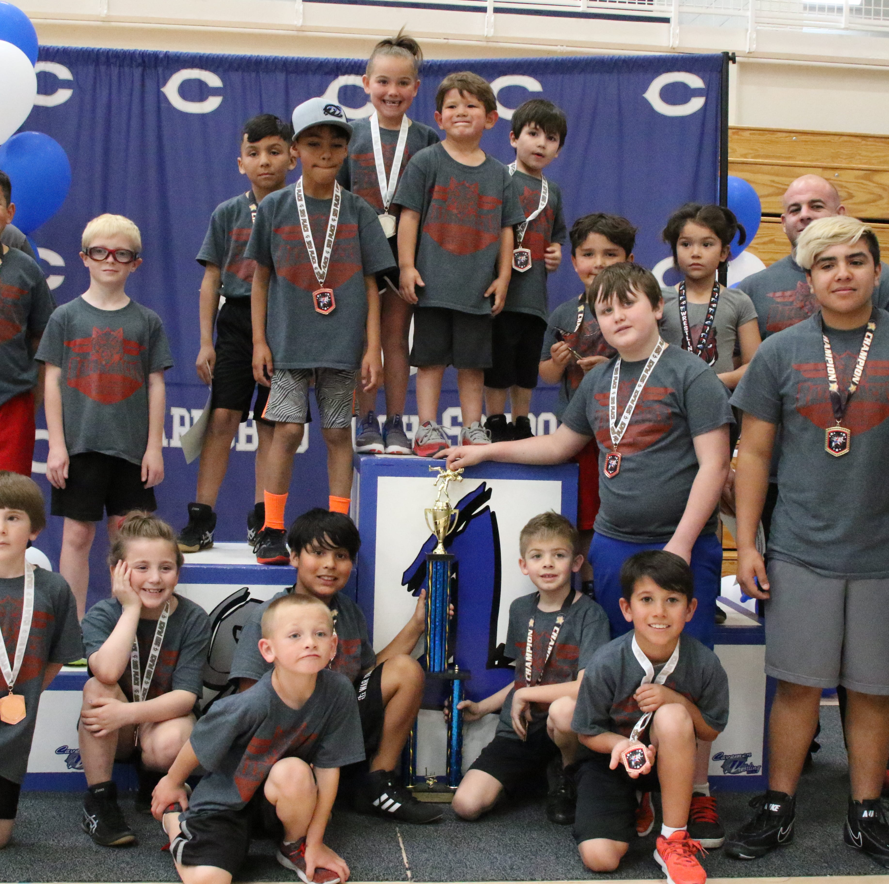 Razorbacks claim first Little Caveman Wrestling title