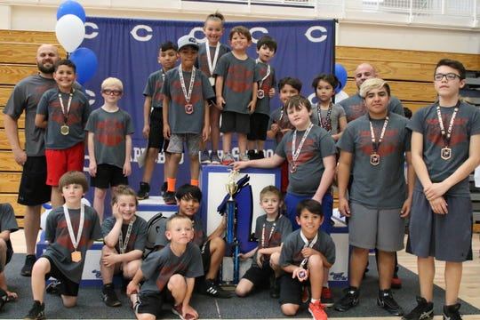 The Razorbacks proudly display their 1st place trophy after competing in the 2019 Little Caveman Wrestling City Championships. The Razorbacks finished with 206 points.