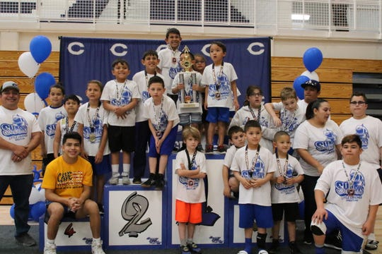 The Sharks proudly display their 2nd place trophy after competing in the 2019 Little Caveman Wrestling City Championships. The Sharks finished with 202 points.