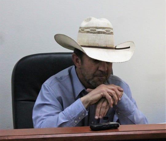 Otero County Commission Chairman Couy Griffin listens to Governor Michelle Lujan Grisham during a conference call Friday afternoon.