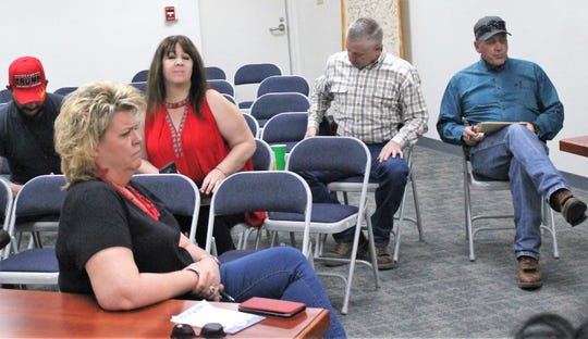 Some high-ranking member of the community sat in on the governor's call Friday afternoon. These included state Rep. Rachel Black, R-District 5, in the foreground, Alamogordo Republican Party Chairwoman Amy Barela, behind Black and Otero County Sheriff David Black, right.
