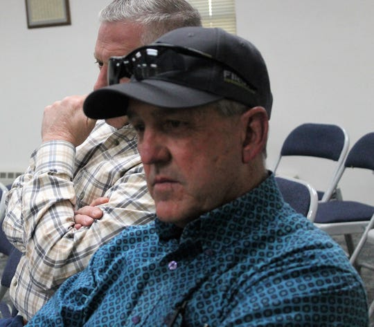 Otero County Sheriff David Black listens to Governor Michelle Lujan Grisham during a conference call Friday afternoon.