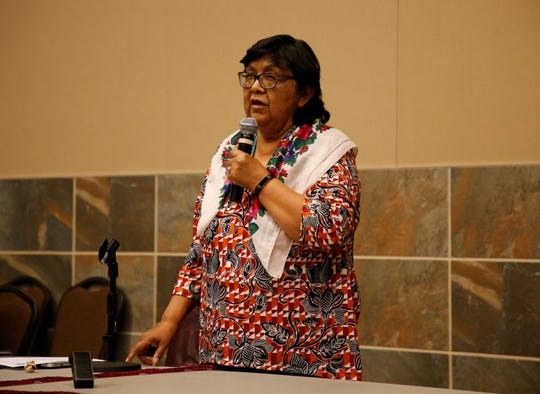 Jennifer Denetdale, chairperson for the Navajo Nation Human Rights Commission, talks about the purpose of the public hearing on Thursday at the Farmington Civic Center.