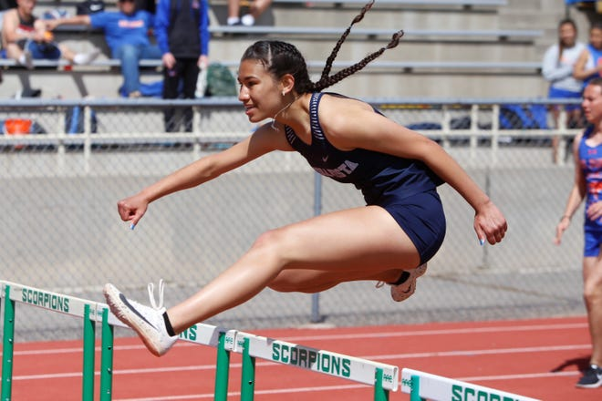 Piedra Vista's Narianna Hernandez jumps over a hurdle in the first heat of the girls 100-meter hurdle during Saturday's Farmington Invitational at Hutchison Stadium. Hernandez placed sixth overall in 19.50 seconds.