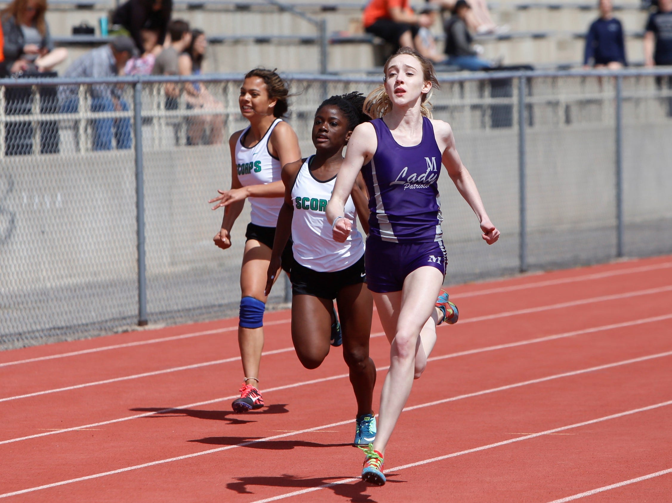 Miyamura's Lauren Cope pulls ahead of Farmington's Jayla Jones (center) in the sixth heat of the girls 100-meter dash during Saturday's FHS Invitational at Hutchison Stadium. Cope placed seventh overall in 13.65 seconds, while Jones was 11th overall in 14.09 seconds.