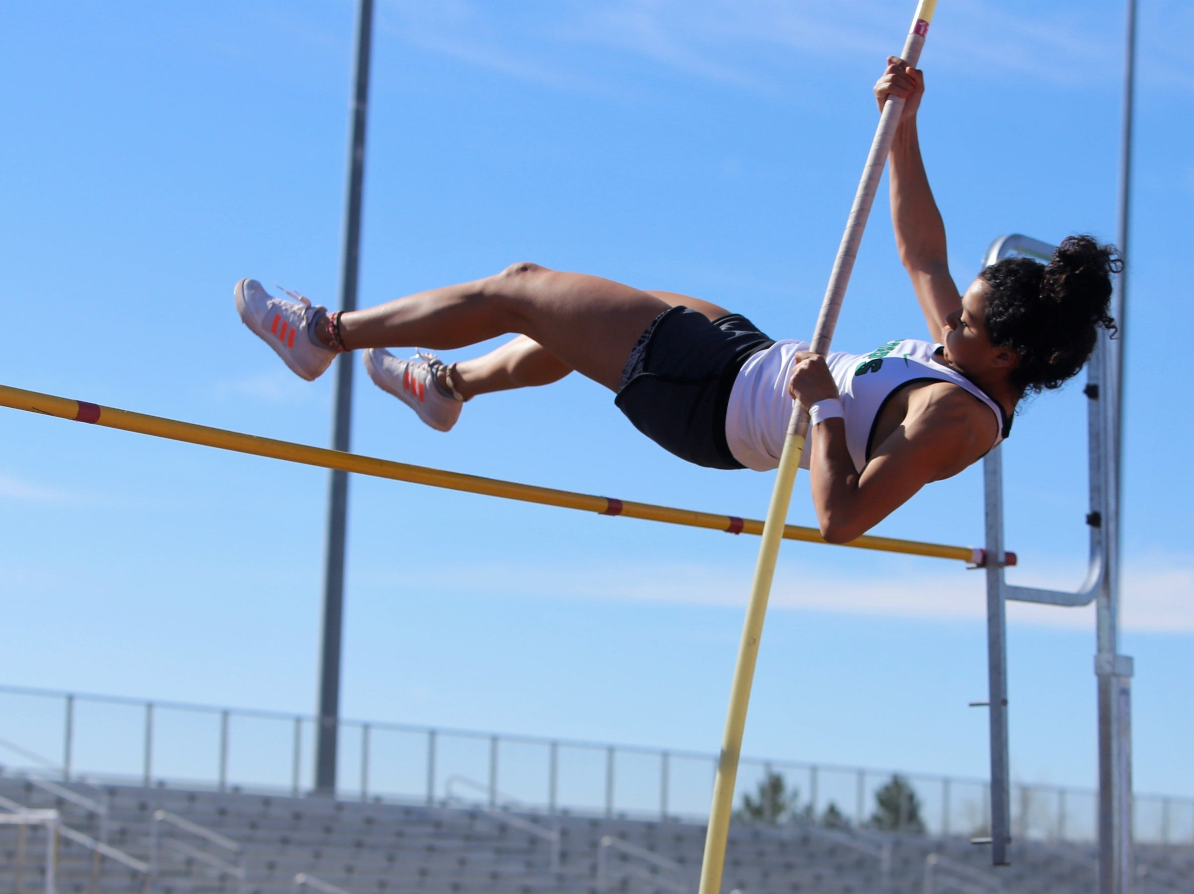 Farmington's Kiara Quezada catapults over the bar in the girls pole vault during Saturday's FHS Invitational at Hutchison Stadium. Quezada won the event with the height of 10 feet, 6 inches.