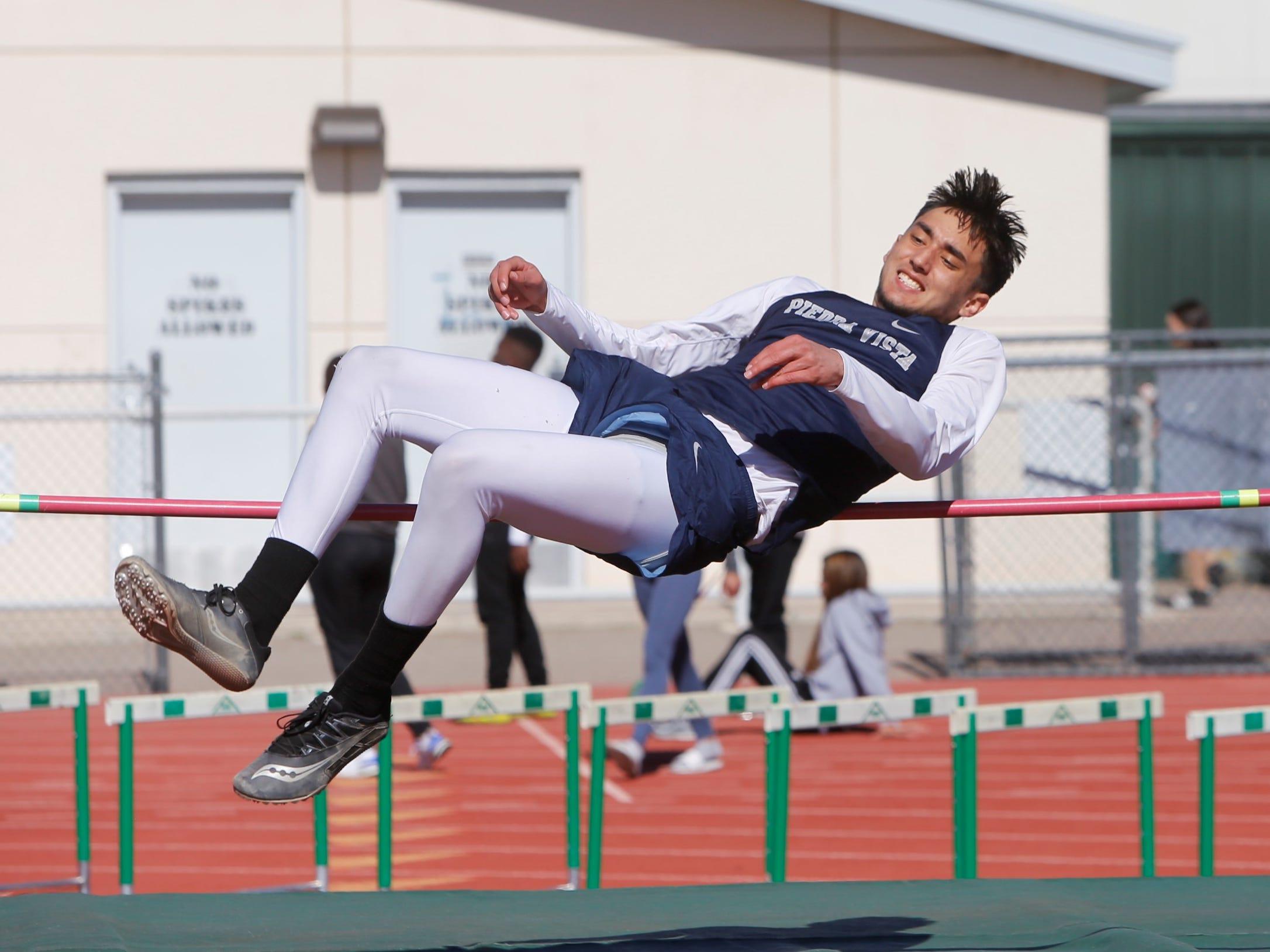 Piedra Vista's Noah Keune flies backward over the bar in the boys high jump during Saturday's Farmington Invitational at Hutchison Stadium. Keune did not place in the event.
