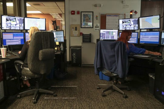 Dispatchers take calls and dispatch officers at the Palm Springs Police Department, March 28, 2019.