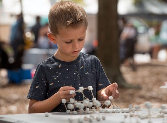 Visitors check out the exhibits Saturday, March 30, 2019 during  the 2nd annual Gulf Coast Science Fest at Seville Square.