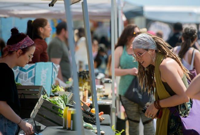 Visitors sample vegan fair, music, yoga and vendors during Pensacola VegFest 2019 at Community Maritime Park.