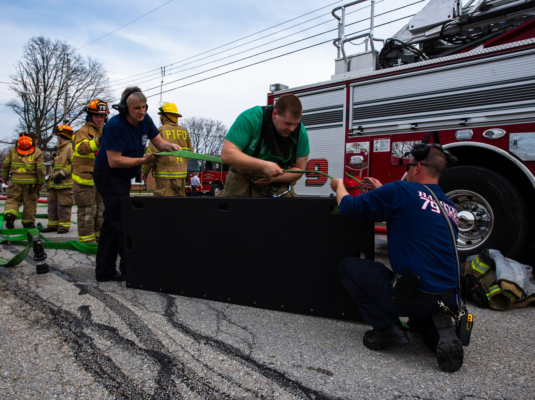Firefighters reload hose at the scene of a house fire on the 100 block of Mumma Ave., Saturday, March 30, 2019, in Penn Township. No one was injured in the fire, which appears to have been an accidental fire in the kitchen, said Hanover Area Fire & Rescue Chief Tony Clousher.