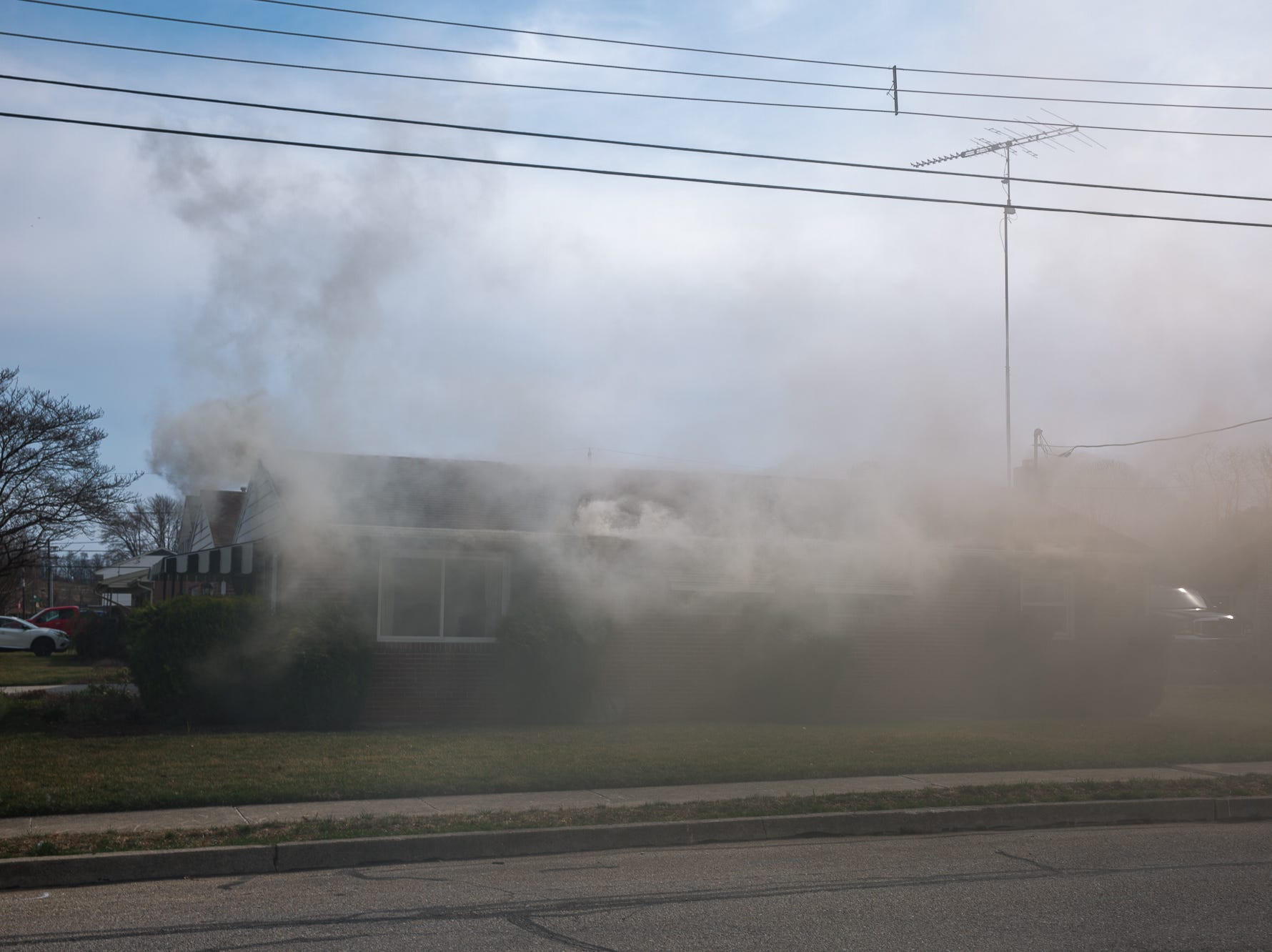 Smoke fills the air as a house burns on the 100 block of Mumma Ave., Saturday, March 30, 2019, in Penn Township. No one was injured in the fire, which appears to have been an accidental fire in the kitchen, said Hanover Area Fire & Rescue Chief Tony Clousher.