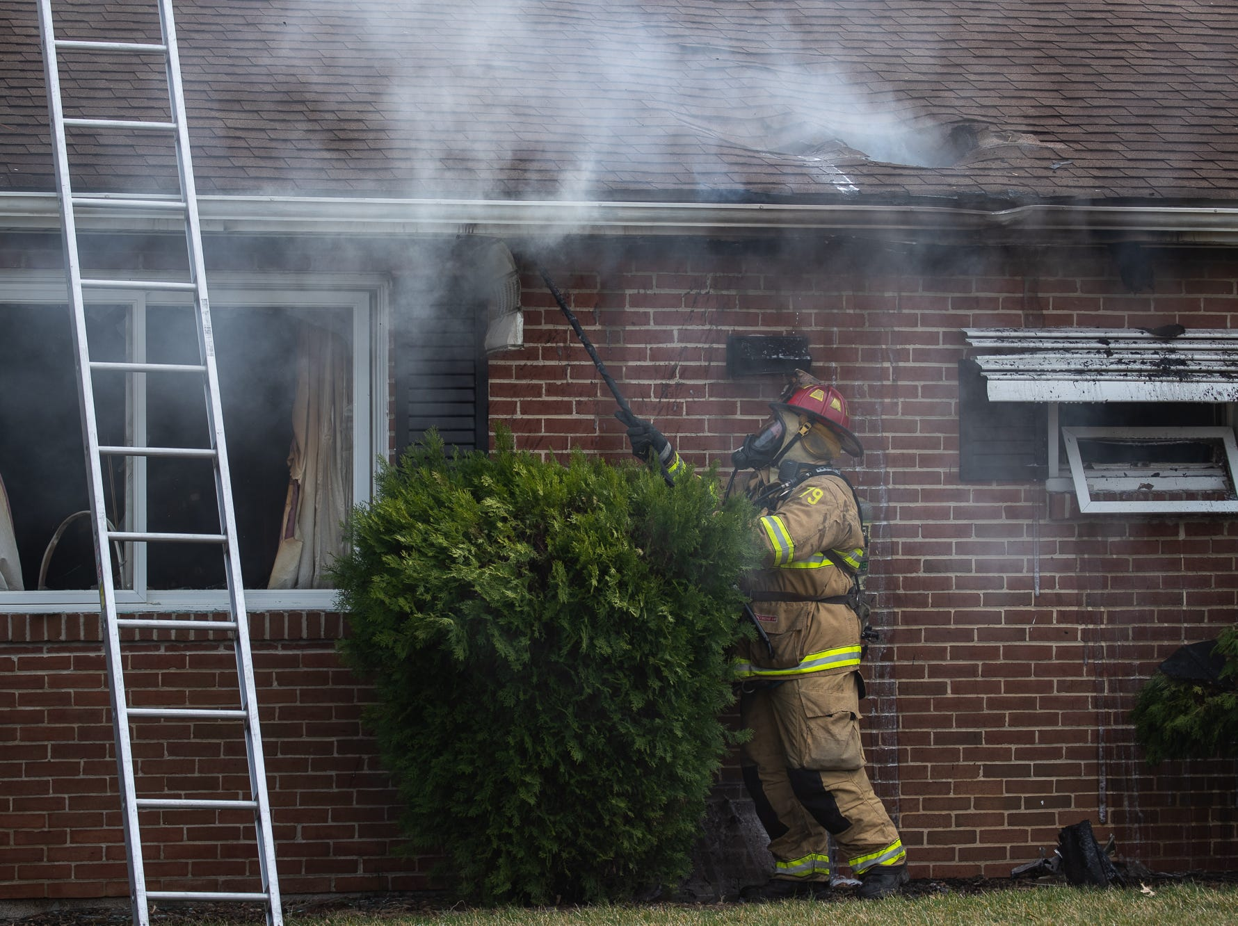 Firefighters work at the scene of a house fire on the 100 block of Mumma Ave., Saturday, March 30, 2019, in Penn Township. No one was injured in the fire, which appears to have been an accidental fire in the kitchen, said Hanover Area Fire & Rescue Chief Tony Clousher.