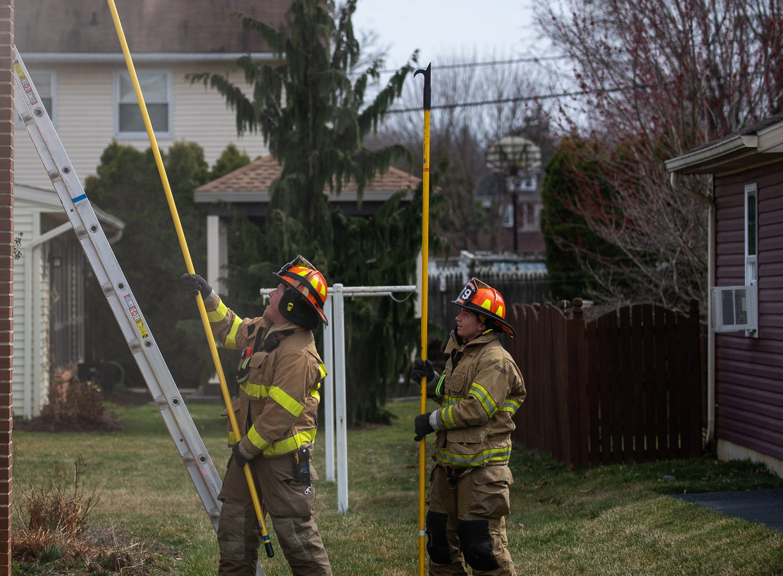 Junior firefighters work at the scene of a house fire on the 100 block of Mumma Ave., Saturday, March 30, 2019, in Penn Township. No one was injured in the fire, which appears to have been an accidental fire in the kitchen, said Hanover Area Fire & Rescue Chief Tony Clousher.