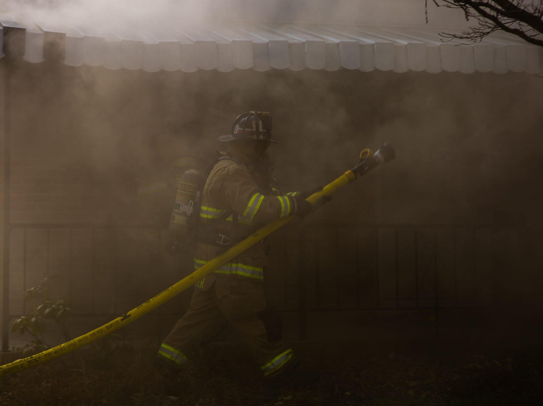 Volunteer firefighter Brady Cromer heads interior to begin the initial interior attack at the scene of a house fire on the 100 block of Mumma Ave., Saturday, March 30, 2019, in Penn Township. No one was injured in the fire, which appears to have been an accidental fire in the kitchen, said Hanover Area Fire & Rescue Chief Tony Clousher.