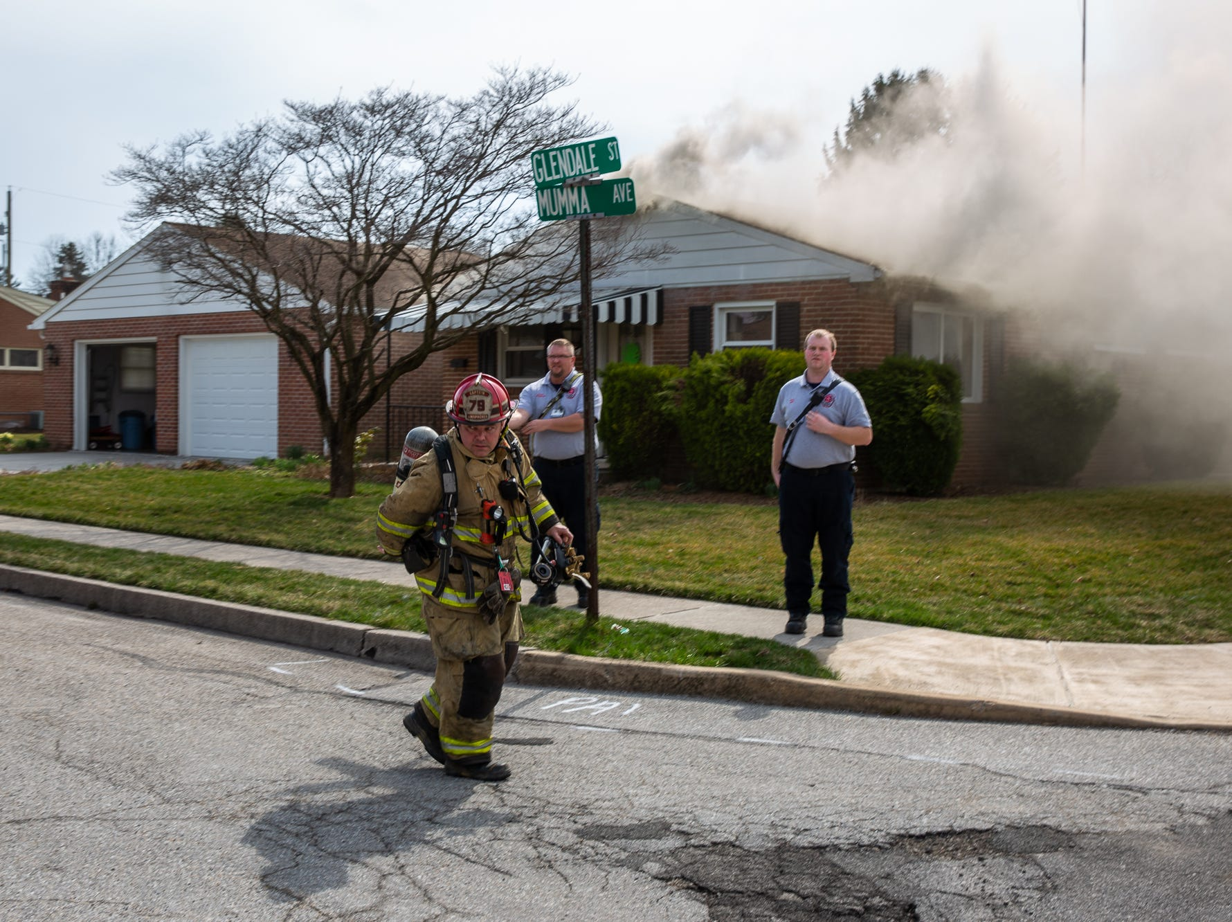 Captain Chuck Amspacher arrives at the scene of a house fire on the 100 block of Mumma Ave., Saturday, March 30, 2019, in Penn Township. No one was injured in the fire, which appears to have been an accidental fire in the kitchen, said Hanover Area Fire & Rescue Chief Tony Clousher.