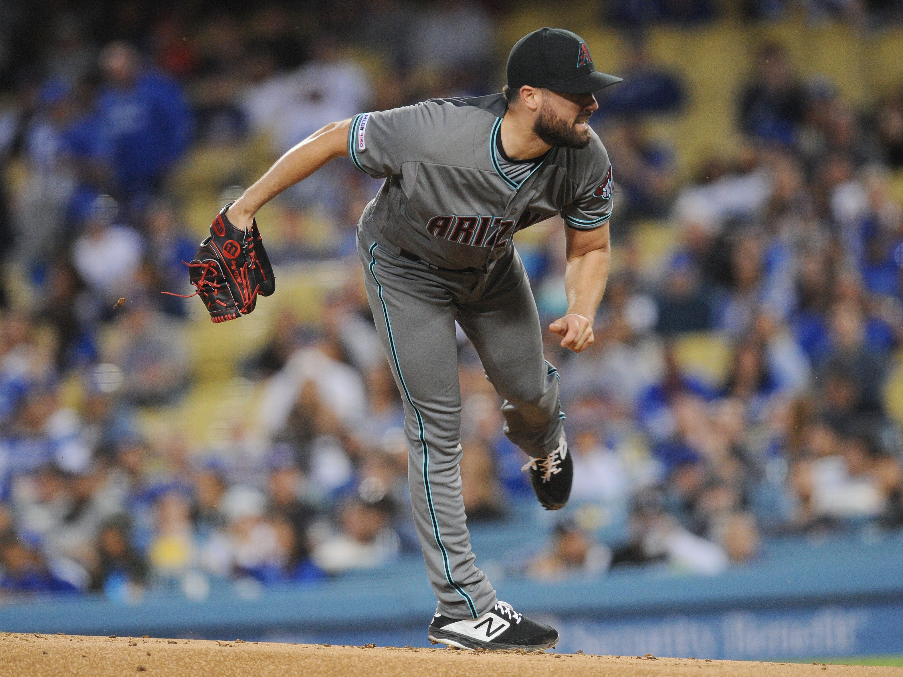 March 29, 2019; Los Angeles, CA, USA; Arizona Diamondbacks starting pitcher Robbie Ray (38) throws during the first inning against the Los Angeles Dodgers at Dodger Stadium.