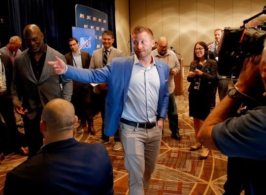 Rams coach Sean McVay speaks to the media as he and Los Angeles Chargers head coach Anthony Lynn, left, view the new Los Angeles Stadium at Hollywood Park on a monitor during the NFL owners meetings.