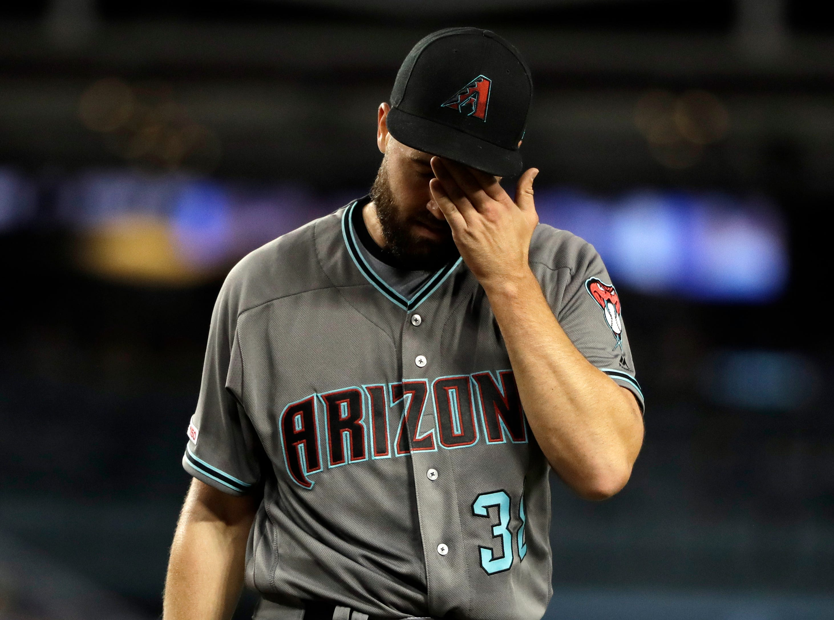 Arizona Diamondbacks starting pitcher Robbie Ray walks off the mound at the end of the third inning of a baseball game against the Los Angeles Dodgers, Friday, March 29, 2019, in Los Angeles. (AP Photo/Marcio Jose Sanchez)
